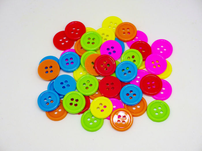 various color circle vintage buttons on white background. Isolated Background Decor Decoration Art Colorful Color Round Shape Cloth Design Object Style View Simple Several Sell Stack Group Hole Small Light Yellow Red Blue Purple Plastic Button Sew Clothing Fashion Circle Dress Many Stitch Accessory Various Classic Retro Pattern Different Wallpaper Repair Select Vintage Variety Circular Craft Industry Fancy