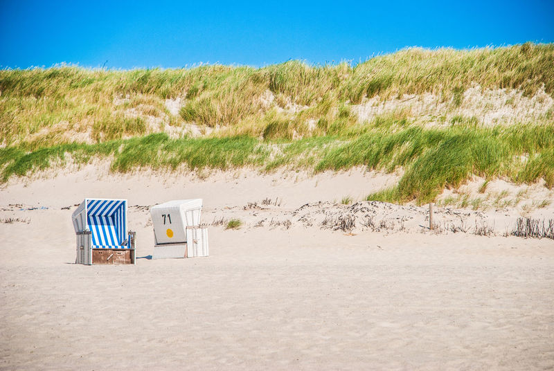 71 Beach Beach Hut Beach Volleyball Blue Clear Sky Day Hooded Beach Chair Lifeguard Hut Marram Grass Nature No People Nordsea Nordsee Outdoors Sand Sand Dune Sea Sky Strandkorb Summer Sunlight Tranquility Vacations