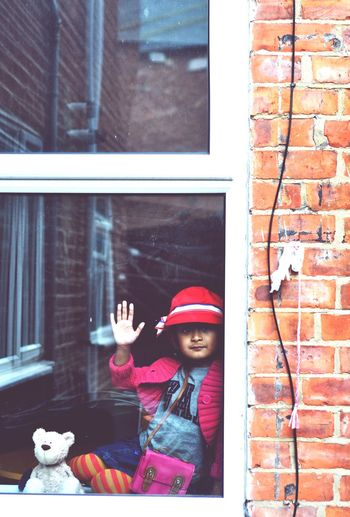 Waiting Childhood One Person Building Exterior Real People Elementary Age Smiling Looking At Camera Window Girls Architecture Warm Clothing Front View