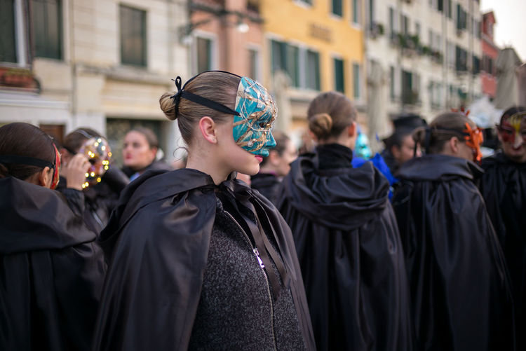 Women wearing mask against buildings8
