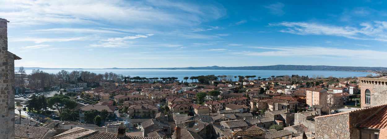 Lago di Bolsena Architecture Building Exterior Building Terrace Built Structure City Cityscape Community Day Downtown District History No People Outdoors Place Of Worship Residential Building Roof Sky Town Travel Travel Destinations Urban Skyline