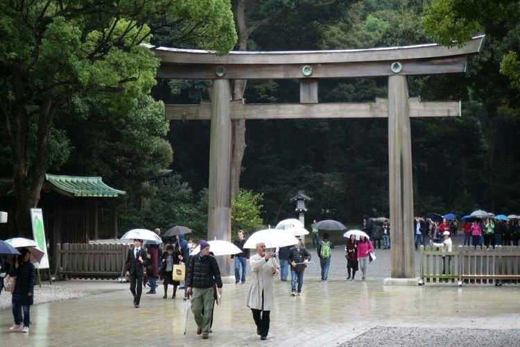 Crowd at torii gate on shinto shrine