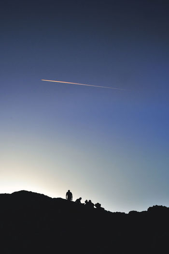 Adult Beauty In Nature Blue Clear Sky Contrail Day Leisure Activity Nature Only Men Outdoors People Scenics Silhouette Sky Two People Vapor Trail