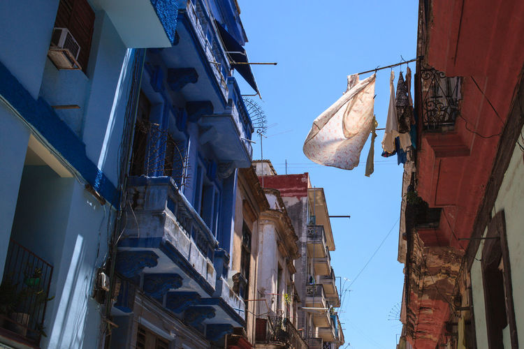 Cuba Cuba Collection Cuba Streets Havana Havanna, Cuba Postcard Streets Of Havana Alley Apartment Architecture Building Building Exterior Built Structure City Clothesline Clothing Day Drying Hanging House Laundry Low Angle View Nature No People Outdoors Postcard From Havana Residential District Sky Textile Window