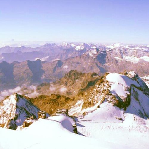 View from top of Granparadiso Mountains Italy Italia france landscape blue sky iceberg trail hiking traveling
