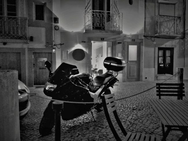 Chair Cobblestone Streets Dark Motorcycle Night Lights Architecture Black Building Exterior Built For Speed Built Structure Cobblestone Cobblestones Darkness And Light Light And Shadow Motorbike Motorcycle Ride Night No People Old Building  Outdoors Parked Parked Motorcycle Photography Themes Table Technology The Week On EyeEm Black And White Friday Mobility In Mega Cities
