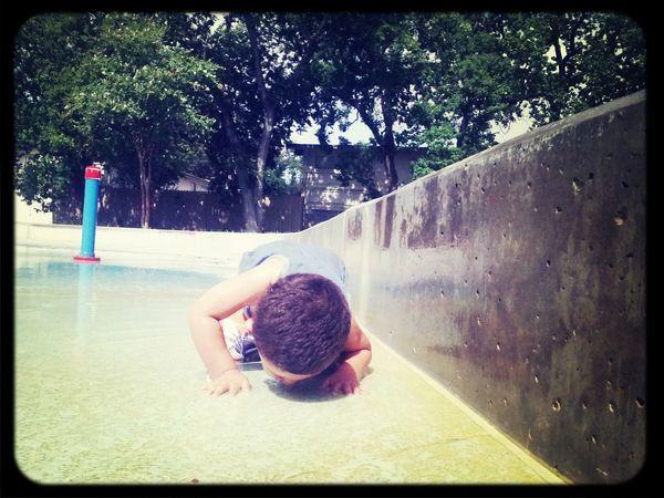 Don't worry, he didn't drink it Playground Water Splash Splashing Water