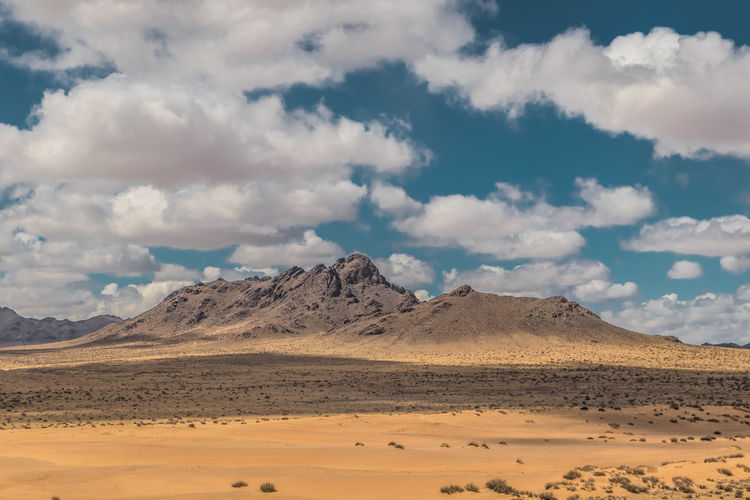 Mongolia Scenics - Nature Cloud - Sky Sky Landscape Environment Tranquil Scene Beauty In Nature Tranquility Non-urban Scene Desert Land Mountain Climate Nature Remote Arid Climate No People Day Idyllic Barren Salt Flat