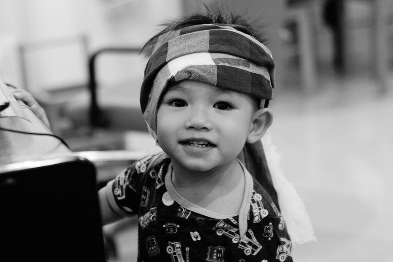 Close-up portrait of cute baby wearing bandana