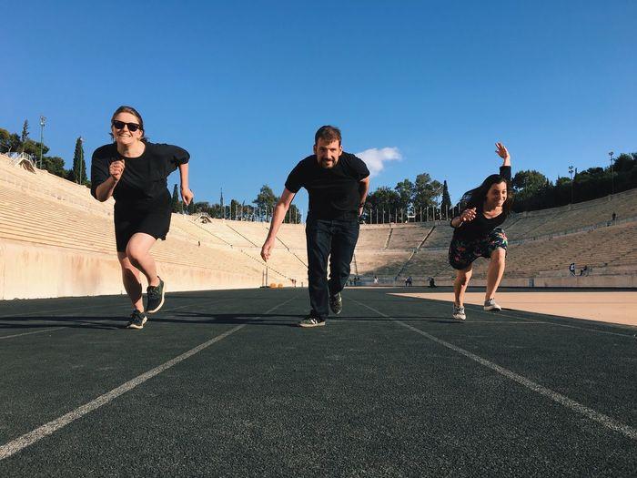 Three people running