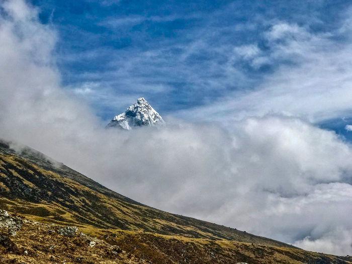 Everest Base Camp Trek - mountain peak above the clouds near Dughla Himalayas Beauty In Nature Cloud - Sky Mountain Mountain Peak No People Scenics - Nature Sky
