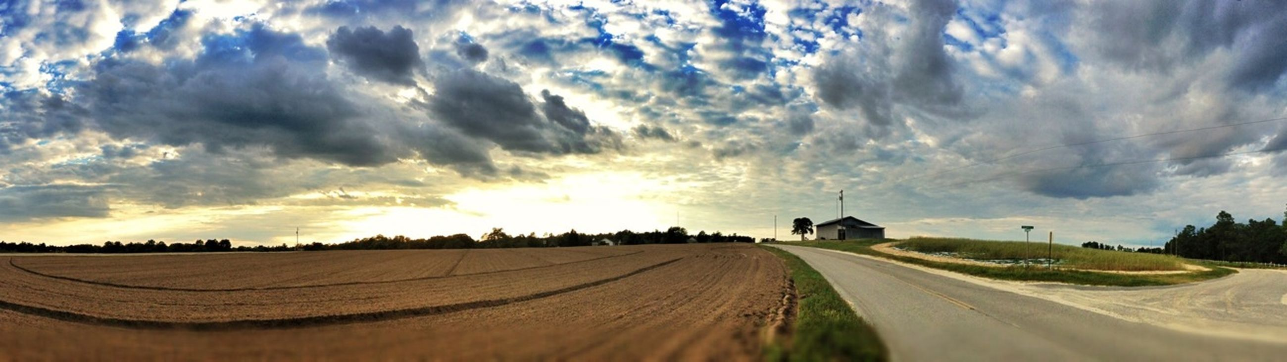 sky, cloud - sky, landscape, rural scene, the way forward, cloud, tranquil scene, cloudy, field, tranquility, agriculture, scenics, nature, sunset, beauty in nature, sunlight, farm, diminishing perspective, vanishing point, dirt road