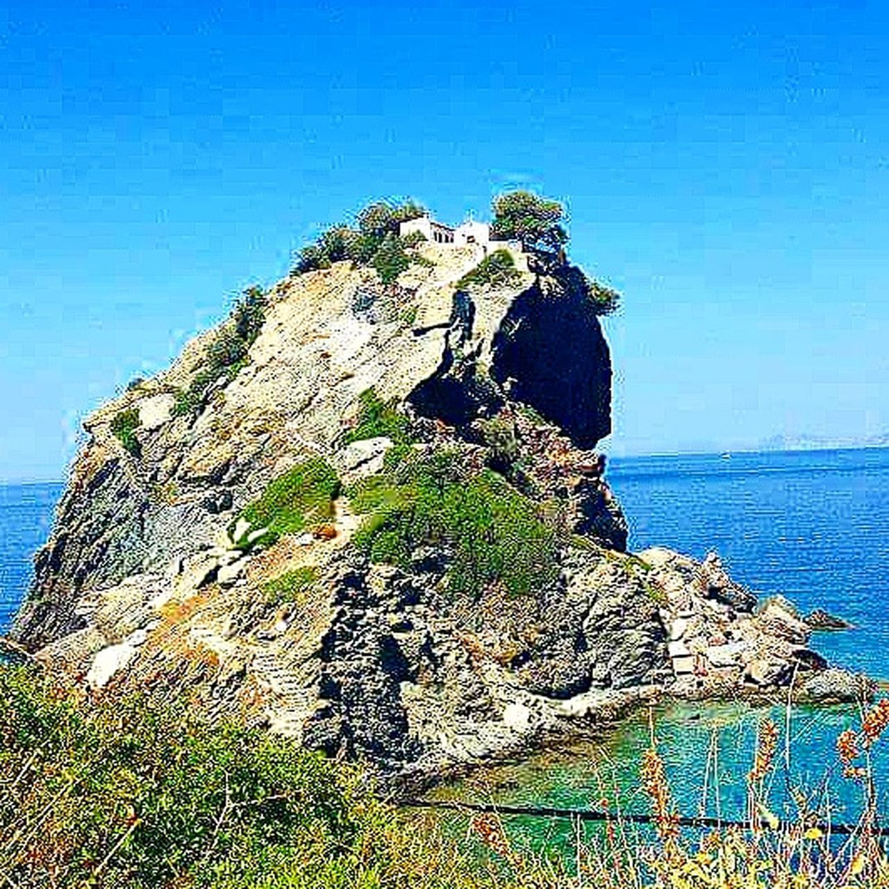 sea, rock - object, scenics, nature, horizon over water, tranquility, water, cliff, outdoors, beauty in nature, beach, day, blue, no people, sky, clear sky