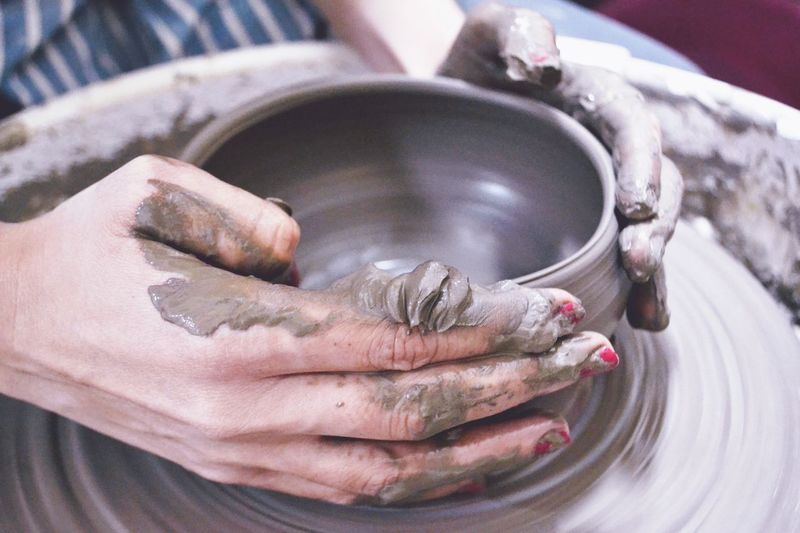 Cropped Hands Of Woman Making Pottery
