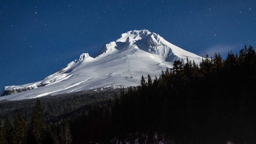 Cascade Mountains Clear Sky Cold Temperature Full Moon Night  Government Camp, Oregon Landscape Mountain Mountain Peak Mountain Range Mt. Hood  Nature No People Oregon Outdoors Portland, OR Sky Snow Snowcapped Mountain Stars Startrails Travel Destinations Winter