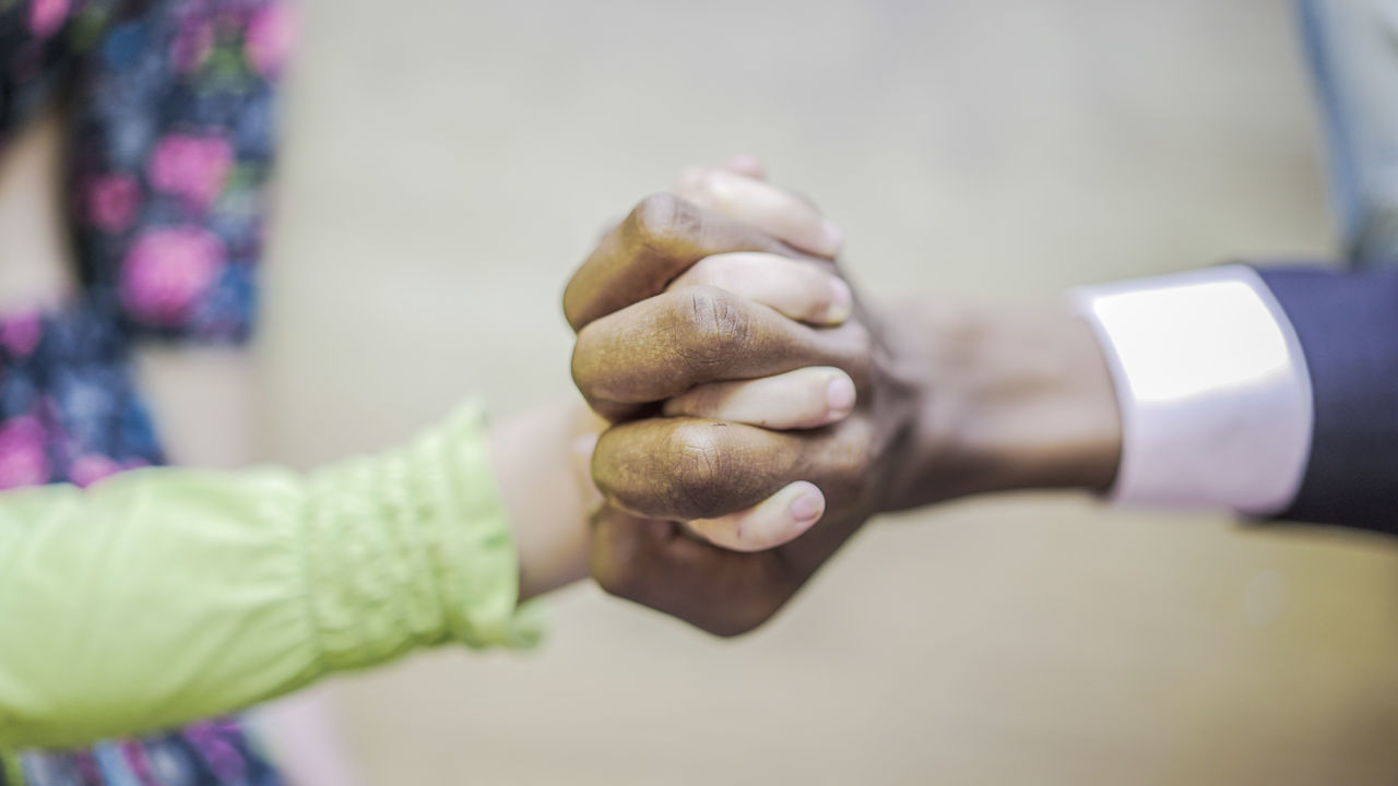 Close-Up Of Man Holding Womans Hand