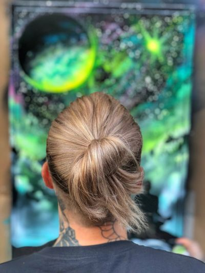 Rear view of woman with multi colored hair