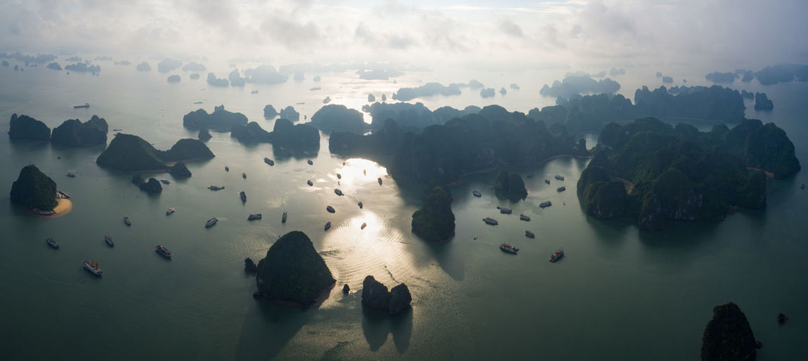 Aerial view of rock formation in sea against sky