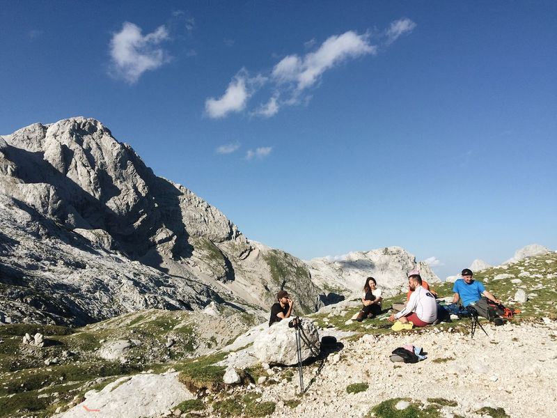 Chillin' near bivouac under Grintovec at an altitude of 2,080 meters, Kamnik-Savinja Alps, Slovenia, 2017. Relaxing Chilling Chillin' Chill Bivouac Kamnik-Savinja Alps Grintovec Mountain Real People Sky Adventure Hiking Nature Medium Group Of People Outdoors Beauty In Nature Rock - Object Leisure Activity Mountain Range Vacations Scenics