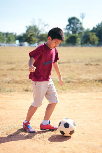 Ball Boys Child Childhood Children Only Day Elementary Age Full Length Lifestyles One Boy Only One Person Outdoors People Playing Real People Soccer Soccer Ball Soccer Player Soccer Shoe Soccer Uniform Sport Sports Uniform Tree The Portraitist - 2018 EyeEm Awards