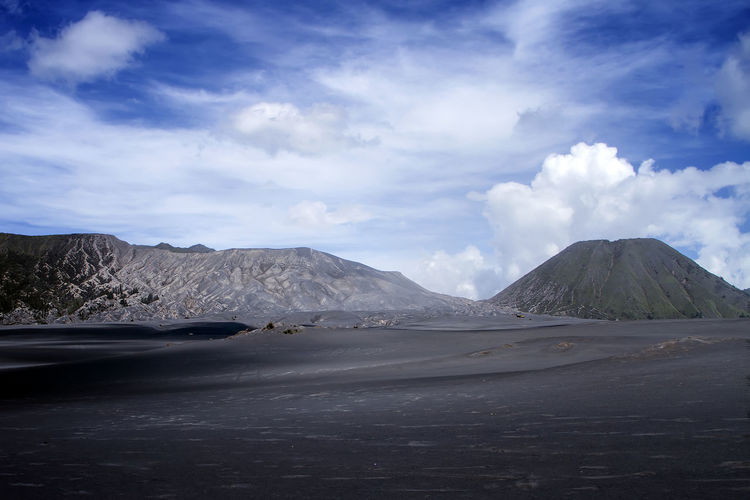 Arjuno mountain at Bromo Tengger National Park, East Java, Indonesia. Beauty In Nature Car Cloud - Sky Day Environment Land Land Vehicle Landscape Mode Of Transportation Mountain Nature No People Non-urban Scene Outdoors Road Scenics - Nature Sky Tranquil Scene Tranquility Transportation Travel