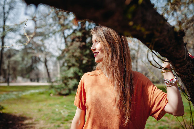 Woman with long hair standing at park
