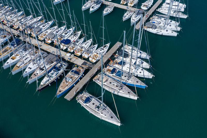 High angle view of sailboats moored at harbor
