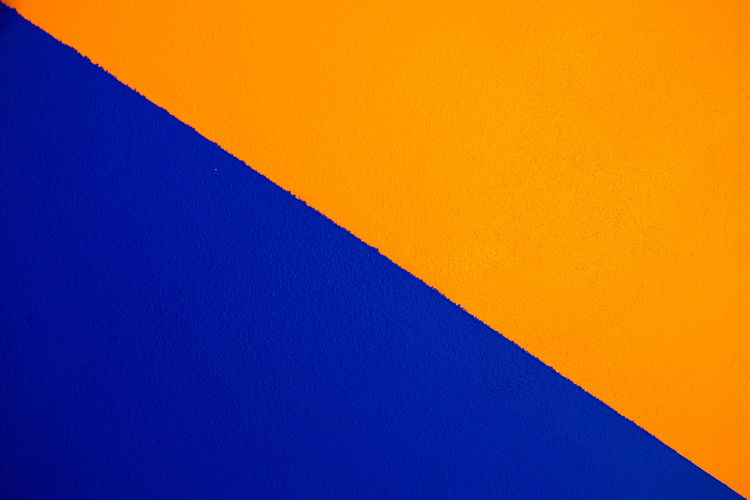 Abstract geometric pattern on concrete wall Abstract Architecture Backgrounds Blue Blue Background Built Structure Clear Sky Close-up Copy Space Day Full Frame Indoors  Low Angle View Multi Colored No People Orange Color Pattern Sky Wall - Building Feature Yellow