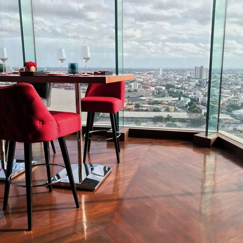 Red Chair on the Rooftop in Bangkok Thailand Bestview Avani Chaopraya River