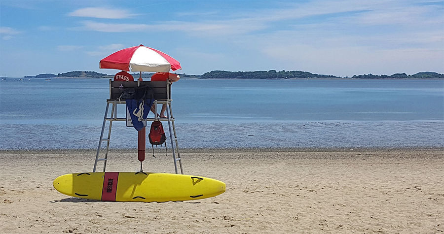 A Life Guards life Hot Day Beach Life Guards Lifeguard  Low Tide Outdoors Safety Sandy Beach Sea Sky Water