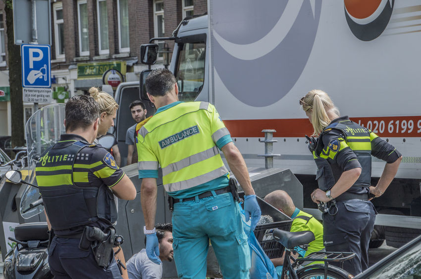 Scooter Accident At The Linnaeusstraat And Eerste Van Swindenstraat Amsterdam The Netherlands 30-5-2018 Amsterdam East Netherlands Policeman Scooter Accident Ambulance Service Ambulance Staff Dutch Holland Police Policewoman
