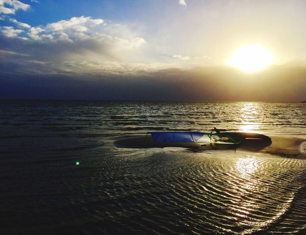 Water Sunset Sky Sea Nature Sunbeam Sunlight Beauty In Nature Nautical Vessel Scenics Sun Transportation Mode Of Transport Tranquility Cloud - Sky No People Outdoors Tranquil Scene Horizon Over Water Day
