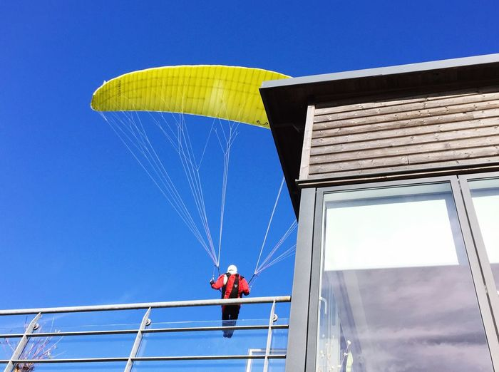 Unexpected Visitor Paraglider Sky Low Angle View Built Structure Architecture Blue Clear Sky Nature My Best Photo