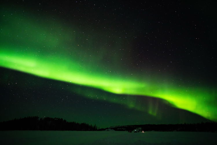 Northern lights (Aurora borealis) with starry sky above forest, Yellowknife, Canada Night Beauty In Nature Sky Scenics - Nature Green Color Space Tranquility Star - Space Tranquil Scene Astronomy Idyllic No People Environment Nature Water Non-urban Scene Illuminated Aurora Polaris Majestic Landscape Outdoors