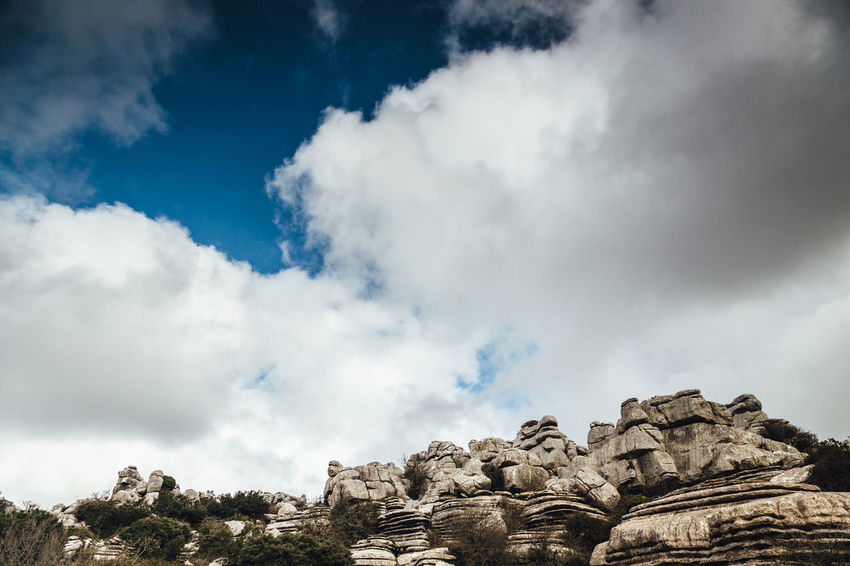 Torcal de Antequera Andalusia Beauty In Nature Blue Cloud Cloud - Sky Cloudy Idyllic Low Angle View Majestic Nature Outdoors Rock Scenics Sierra Del Torcal Sky Torcal De Antequera Tranquil Scene Tranquility Travel Weather