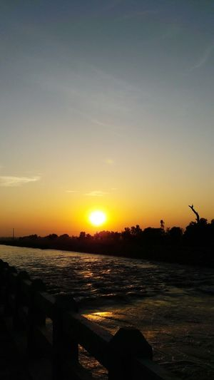 In Pakistan Sunset Beautiful Nawanlahore Eyeem Pakistan Mobilephotography Sunset_collection Canalporn Riflectionswater Water Reflections