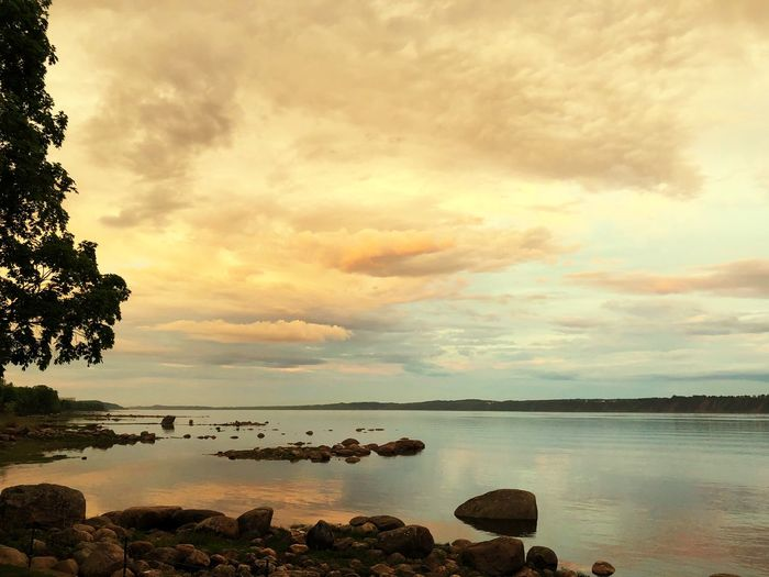 Cloud - Sky Water Sky Scenics - Nature Beauty In Nature Sunset Tranquility Tranquil Scene Sea Tree Nature Plant Reflection No People Land Outdoors Horizon Idyllic Beach Rock