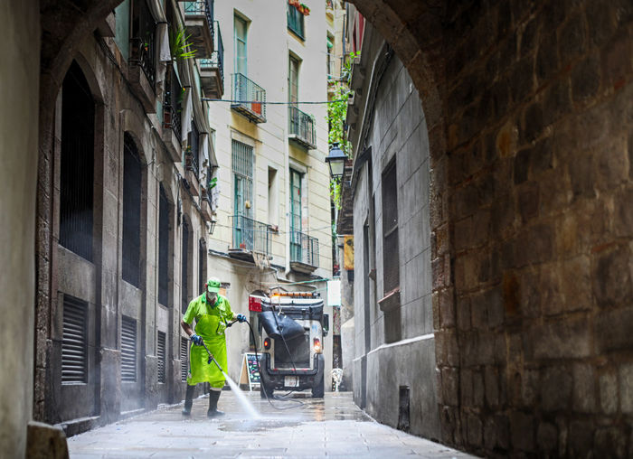 yellow cleaning Paint The Town Yellow Adult Adults Only Alley Architecture Building Exterior Built Structure City Day Full Length Men One Person Outdoors People Real People Reflective Clothing Working