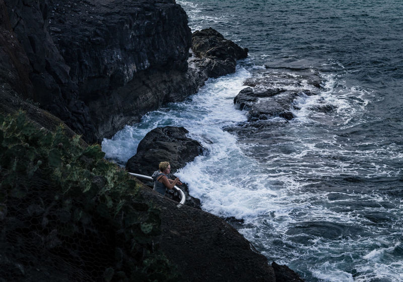 Watching The Sea Moody Cactus Cacti Real People Rough Sea Nature Photography Woman Evening Light Evening Light Waves Crashing Waves And Rocks Waves, Ocean, Nature Looking Lanscape Photography Enjoying The View Colour Your Horizn