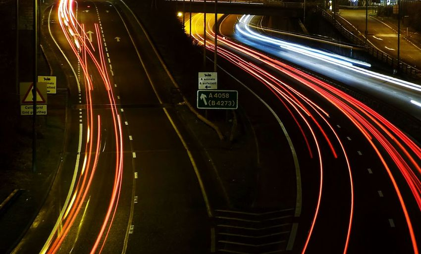 Light trails on highway in city at night