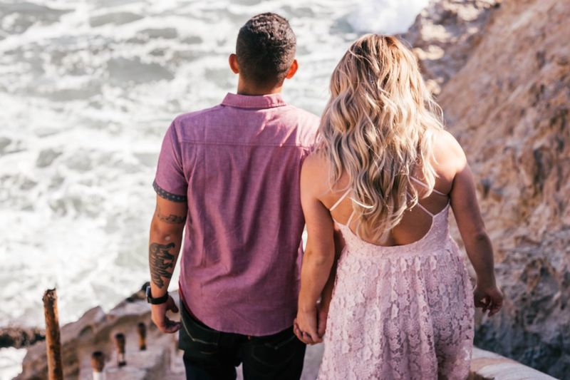 Rear view of couple standing on rock