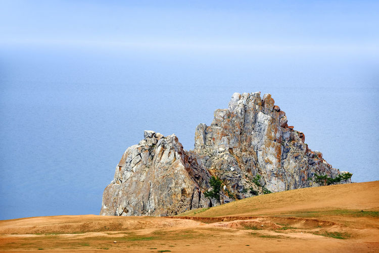 Rocky cliff against sky