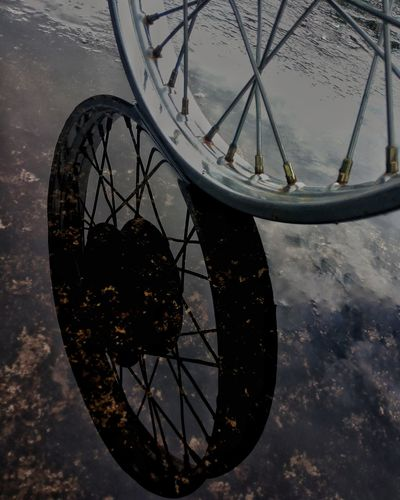 Bicycle Ferris Wheel No People Close-up Minute Hand Reflection Wheel Rim Bike Rims And Wheel The Week On EyeEm EyeEmNewHere Water Reflections Reflections Mobography Mix Yourself A Good Time