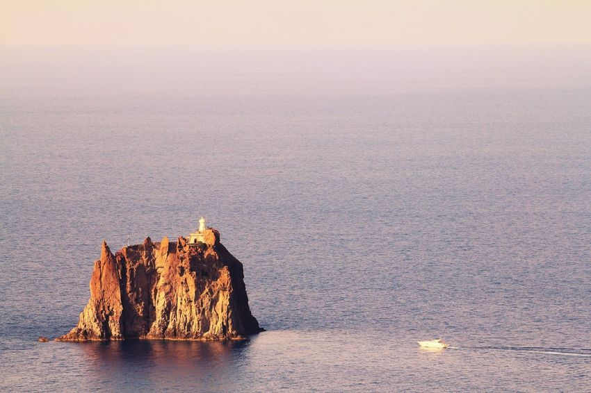 Rock Rock Formation Fort Fortress Prison Isolated Seascape Sunset Sunset_collection Sunsets Boat Hidden Gems  Sea Sea And Sky Horizon Over Water Horizon Travel Traveling Popular Reflection Reflections In The Water EyeEm Gallery Strombolicchio Stromboli Italy