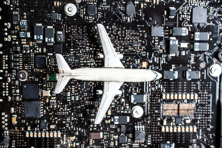 Directly Above Shot Of Model Airplane On Computer Chip