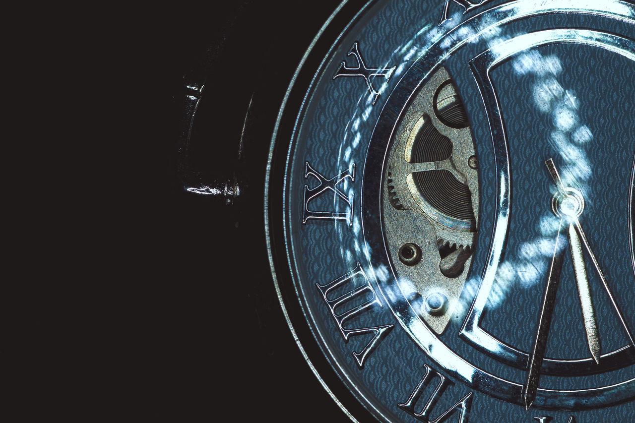 CLOSE-UP OF CLOCK WHEEL
