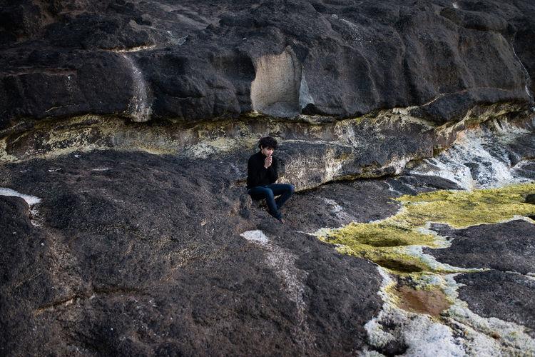 Full length of man praying outdoors