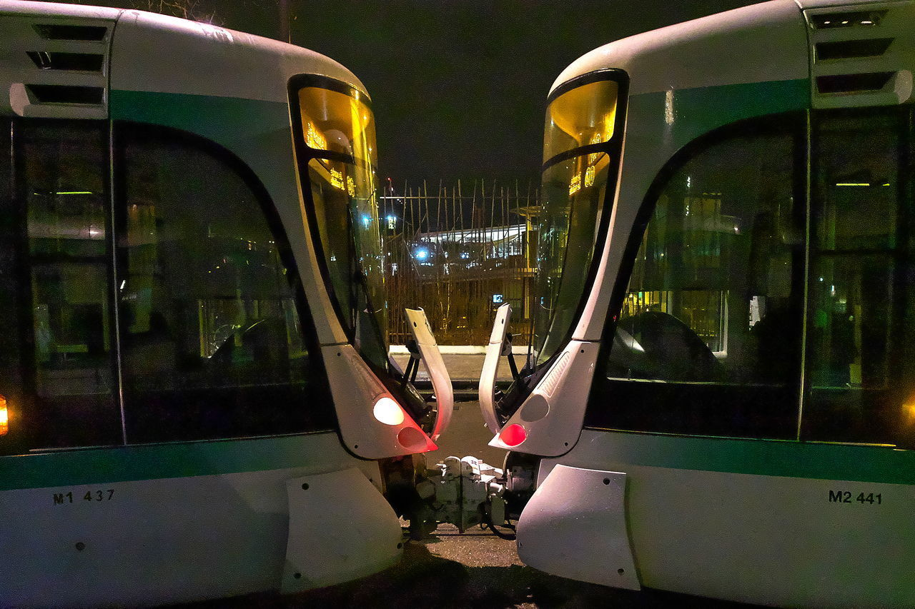 REFLECTION OF ILLUMINATED CAR IN CITY