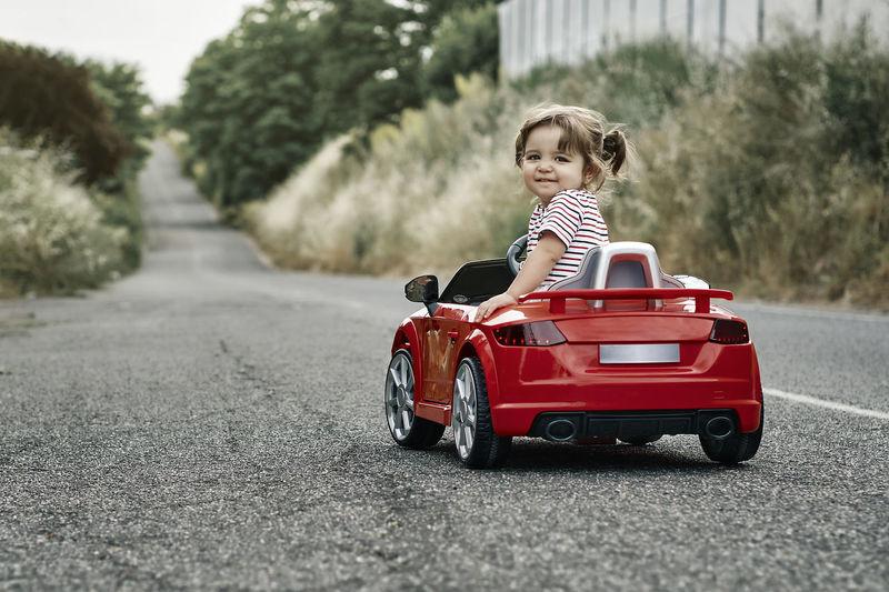 Boy toy car on road