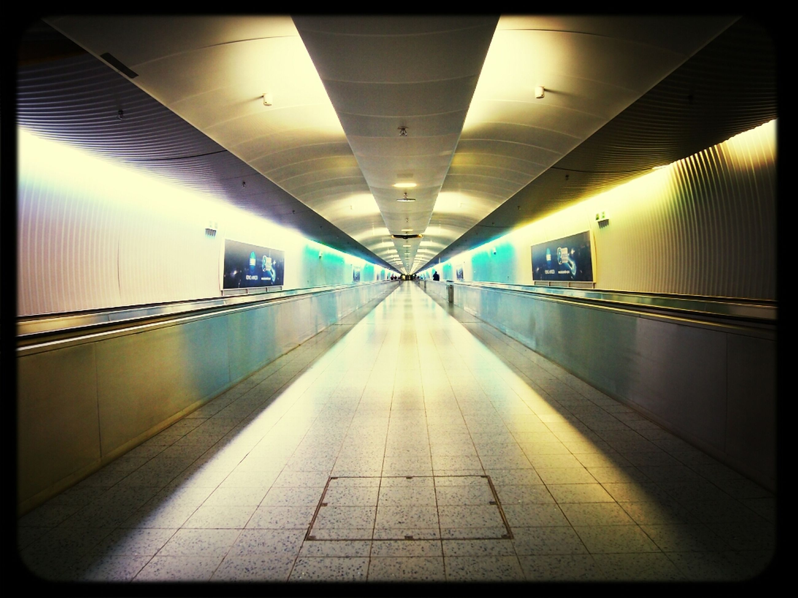 indoors, illuminated, the way forward, ceiling, transfer print, corridor, diminishing perspective, lighting equipment, architecture, auto post production filter, flooring, built structure, empty, tunnel, tiled floor, subway, vanishing point, underground, underpass, tile
